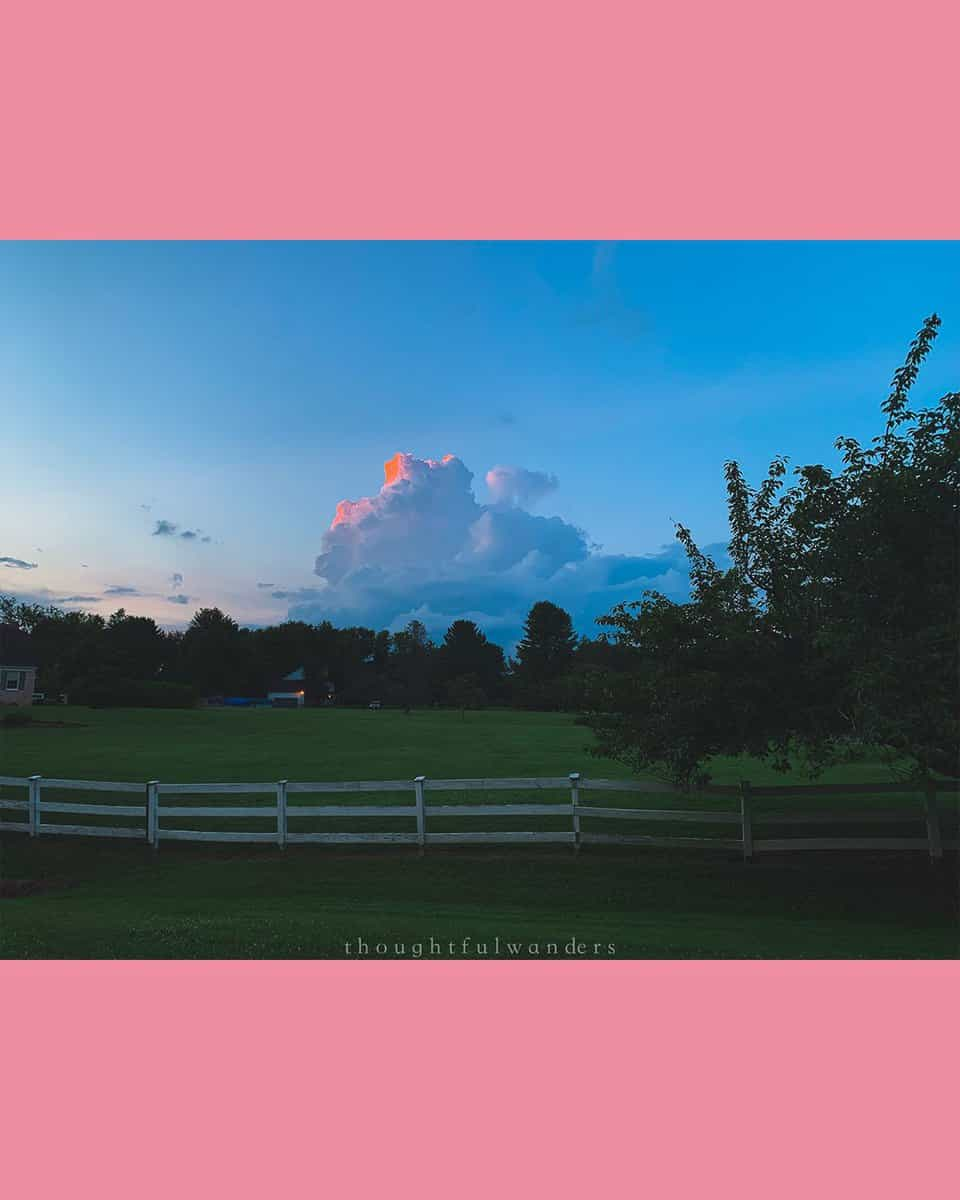 cloud sunset with pink glow and blue skies