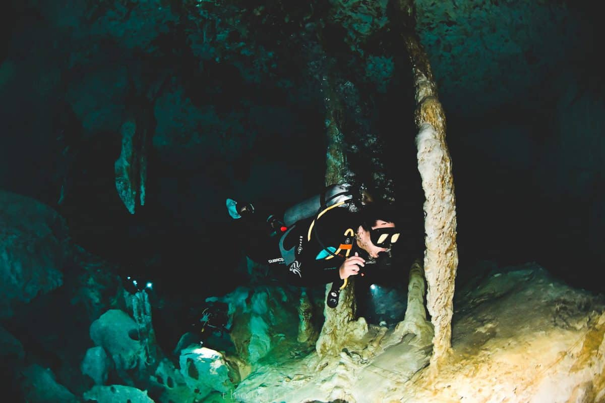 asian woman scuba diving dos ojos cenote